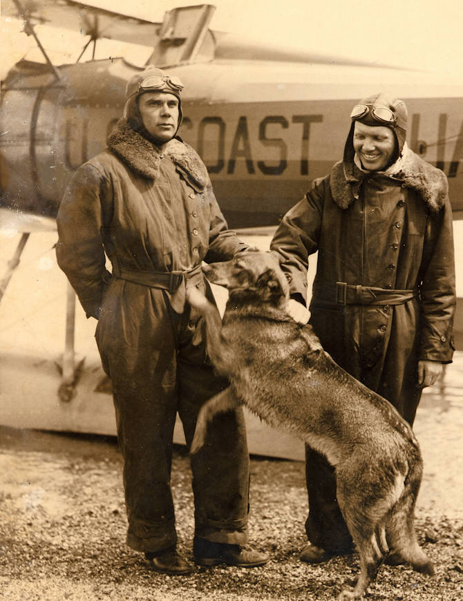 "U.S. Coast Guard Lt. Cmdr. Carl Christian von Paulsen (left), his dog ""Brutus"" and co-pilot Ensign Lawrence Melka, pose in front of their borrowed navy Vought UO-1 amphibian biplane at Gloucester, Massachusetts. (Photo courtesy of the von Paulsen family)"