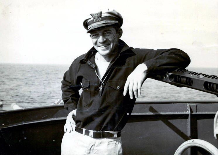 U.S. Coast Guard Lt. j.g. Charles Eliot Winslow at sea aboard Coast Guard Cutter Argo. Notice the forward 20mm cannon barrel located under his arm. (Photo courtesy of the Winslow Family)