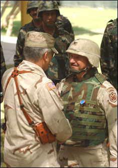 Gen. George Casey, commander of Multi-National Forces-Iraq, congratulates U.S. Army Col. James H. Coffman Jr. after pinning him with the Distinguished Service Cross in front of a formation of Iraqi Special Police Commandos.