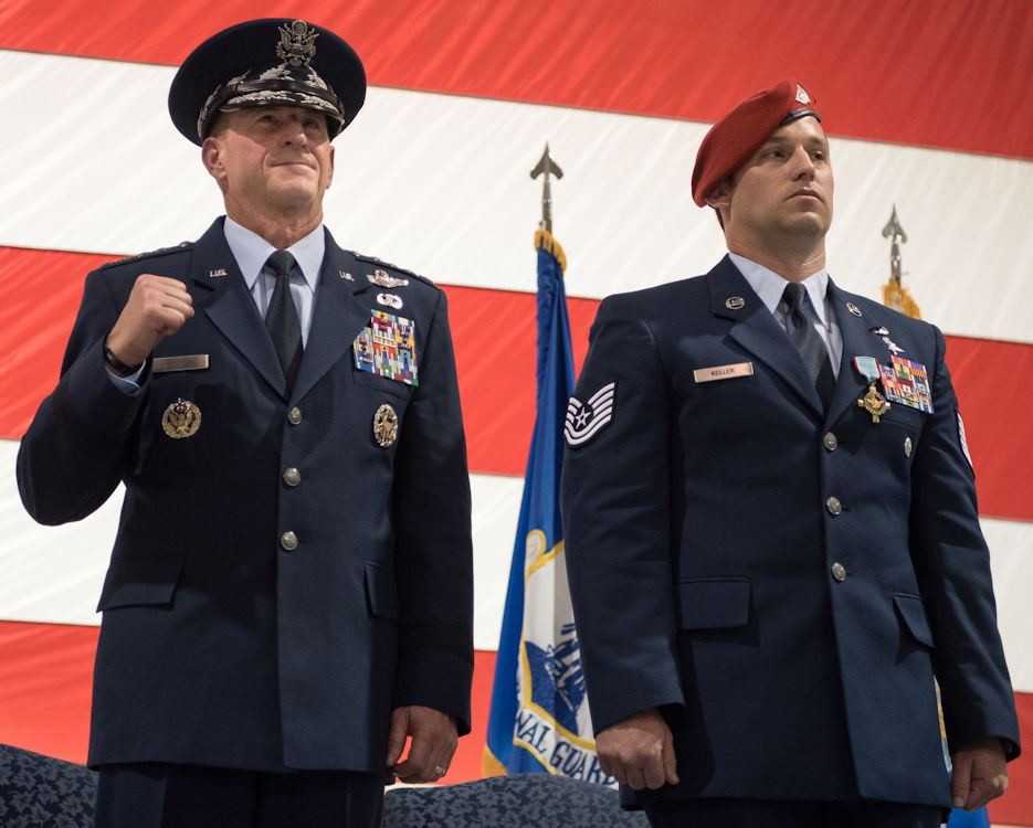 September 13, 2019 - Air Force Chief of Staff Gen. David L. Goldfein (left) pumps his fist during the playing of the Air Force Song at a ceremony held at the Kentucky Air National Guard Base in Louisville, KY. Earlier in the ceremony, Goldfein presented Tech. Sgt. Daniel Keller (right), a combat controller in the 123rd Special Tactics Squadron, with the Air Force Cross, which Keller earned for valor on the battlefield in Afghanistan. (U.S. Air National Guard photo by Staff Sgt. Joshua Horton)