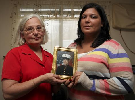 Donna and Stephanie Ouellette, mother and sister of fallen Marine Cpl. Michael W. Ouellette, where honored in a ceremony conducted by Marines with 2nd Marine Division when they were presented the Navy Cross on behalf of Cpl. Ouellette Nov. 10, 2010. On March 22, 2009, an improvised explosive device detonated underneath Cpl. Ouellette, severely wounding him, while on a foot patrol in the Now Zad district of Helmand province, Afghanistan. However, Cpl. Ouellette continued to lead his Marines of 1st Squad, Company L, 3rd Battalion, 8th Marine Regiment, by directing fire and thwarting the Taliban's attack. He later succumbed to his wounds, just moments after he was evacuated from the area.