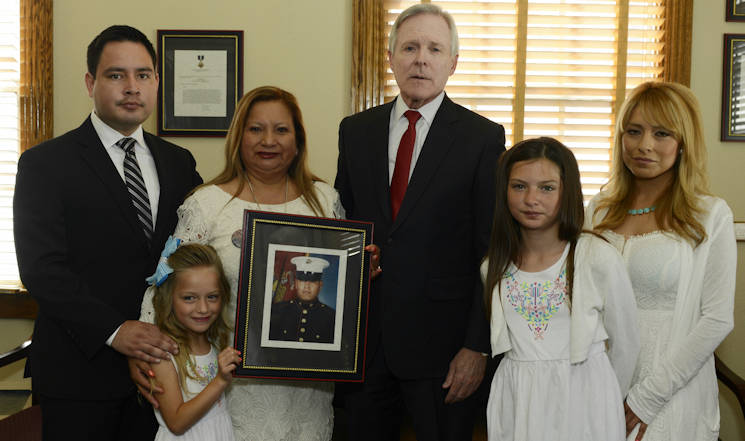 CAMP PENDLETON (June 8, 2015) Secretary of the Navy (SECNAV) Ray Mabus poses for a group photo with the family members of Marine Sgt. Rafael Peralta before presenting them with a Navy Cross, the Navy and Marine Corps' second highest medal for valor at Camp Pendleton. Mabus posthumously awarded the medal for actions Peralta took in 2004. (U.S. Navy photo by Chief Mass Communication Specialist Sam Shavers)
