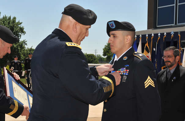 Army Chief of Staff Gen. Raymond T. Odierno presents Army Sgt. Felipe Pereira with the Distinguished Service Cross at Fort Campbell, Ky., April 12, 2012. Pereira earned the military's second-highest award for his actions Nov. 1, 2010, in Afghanistan. U.S. Army photo by Sam Shore