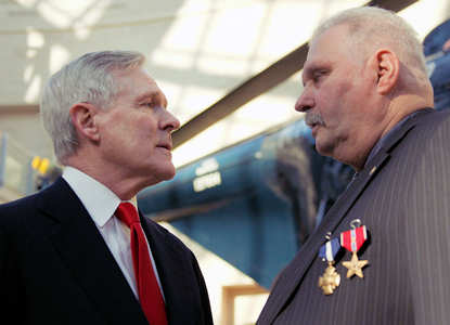 "Navy Secretary Roy Mabus speaks to Ned E. Seath after presenting him with the Navy Cross and the Bronze Star Medal with ""V"" device for valor in a ceremony at the National Museum of the Marine Corps in Quantico, Va., Feb. 11, 2011. U.S. Marine Corps photo by Lance Cpl. Christofer P. Baines"