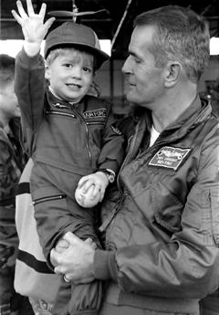 Then-Lt. Col. Jim Gibbons, now the governor of the state of Nevada, holds his son Jimmy on the flight line prior to the Nevada Air Guard's 1990 deployment in support of operations Desert Shield and Desert Storm. Gibbons would be awarded the Distinguished Flying Cross for his extraordinary achievements as a flight leader during the conflict. Nevada Air National Guard photo courtesy of the152nd Airlift Wing. Courtesy photo