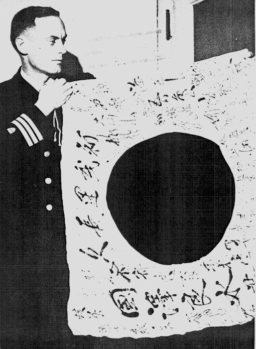 "Cover of the March 1943 Coast Guard Magazine reads: ""Jap Trophy-Comdr. Dwight Dexter, USCG, displays autographed flag taken from Jap soldier."" (U.S. Coast Guard courtesy image)"