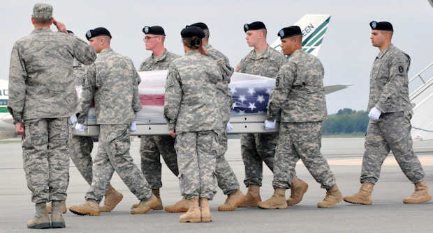 Air Force Col. David E. Pollmiller (left), commander, Operations Group 436th Airlift Wing, and Brig. Gen. Rhonda Cornum (right), director, Comprehensive Soldier Fitness, render honors to the remains of Sgt. 1st Class Daniel R. Adams, 1st Battalion, 10th Special Forces Group (Airborne), during a dignified transfer conducted by the 3rd U.S. Infantry Regiment (The Old Guard) soldiers on Sept. 15, 2011 at Dover Air Force Base, Del. Photo by Army Staff Sgt. Megan Garcia