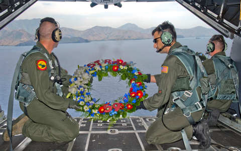 Loadmasters assigned to the 1st Special Operations Squadron prepare to release a wreath from an MC-130H Combat Talon II Feb. 26, 2011, in memory of fallen brethren lost 30 years ago, when a 1st SOS MC-130E, call sign STRAY 59, crashed during an exercise, killing eight crewmembers and 15 passengers. U.S. Air Force photo/Staff Sgt. Jonathan Steffen