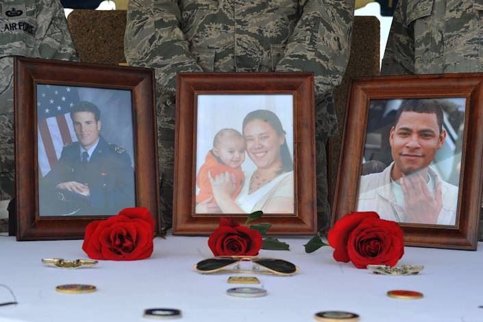 "Photos of Capt. Mark Tyler Voss, Capt. Victoria A. Pinckery and Tech. Sgt. Herman ""Tre"" Mackey III sit among a table of mementos at the Shell 77 Memorial Service at McConnell Air Force Base, Kan., May 28, 2013. The airmen were deployed to the 376th Air Expeditionary Wing's 22nd Expeditionary Air Refueling Squadron in support of Operation Enduring Freedom during the time their KC-135 Stratotanker tragically crashed May 3, 2013 in Kyrgyzstan. (U.S. Air Force photo by Staff Sgt. Jess Lockoski)"