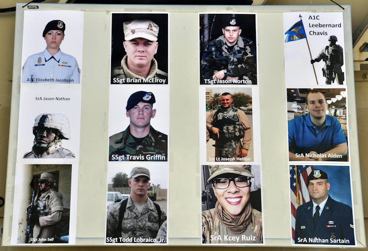 "A collage of the 12 fallen Defenders hanging at the start of the ""Ruck to Remember,"" a 12-kilometer ruck march at Bagram Air Field, Afghanistan, Dec. 12, 2015. The event was designed to honor the sacrifices these Defenders made and to celebrate their lives. (U.S. Air Force photo by U.S. Air Force Tech. Sgt. Nicholas Rau)"