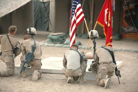 Marines from Delta Company, 4th Combat Engineer Battalion, kneel at the battlefield memorials to pay their final respects to Cpl. Kristopher D. Greer and Gunnery Sgt. Floyd E. Holley during a memorial service at Forward Operating Base Rankel, Helmand province, Afghanistan, Sept. 2, 2010. Greer and Holley were killed in action Aug. 8 and Aug. 29, respectively, while conducting combat operations in Helmand province, Afghanistan.