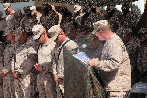 Navy Lt. Cmdr. Danny Purvis, a chaplain for 2nd Marine Division, delivers the invocation for U.S. Marines with Alpha Company, 1st Battalion, 5th Marines, as they mourn the loss of two Marines during a memorial ceremony in Sangin, Afghanistan May 4. The ceremony was for Lance Cpls. Joe Jackson and Ronald Freeman, who were killed in action while conducting combat operations in support of International Security Assistance Forces and Operation Enduring Freedom. U.S. Marine Corps photo by Corporal Nathan McCord