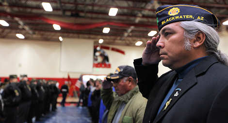 Native American veterans salute as USMC Lance Cpl. Joe Jackson's body is carried into the White Swan High School gymnasium for funeral services, May 2, 2011. Jackson was killed April 24, 2011 by an improvised explosive device blast in Afghanistan. Official Marine Corps photo by Cpl. Jad Sleiman