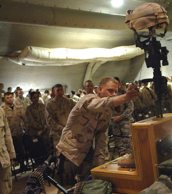 U.S. Air Force Senior Airman Daniel Hunsperger says goodbye to his supervisor, U.S. Air Force Staff Sgt. John T. Self, during a May 18, 2007 memorial ceremony in the town hall at Balad Air Base, Iraq. Sergeant Self died during combat operations May 14, 2007 in the Baghdad area. Airman Hunsperger is with Det. 3, 332nd Expeditionary Security Forces Squadron. (U.S. Air Force photo/Tech. Sgt. Alan Port)