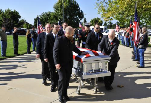 Family and friends of Senior Airman Daniel Johnson escort his remains into the First Christian Church Oct. 13, 2010, in Santa Maria, Calif. Airman Johnson, a 30th Civil Engineer Squadron explosive ordnance disposal flight technician, was killed in the line of duty Oct. 5, 2010, in Kandahar, Afghanistan. U.S. Air Force photo by Tech. Sgt. Luke Thelen