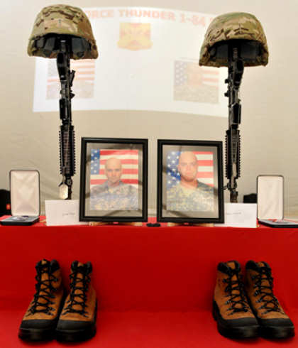 A memorial stand of Staff Sgt. Scott Burgess and Staff Sgt. Michael Lammerts was on display during a memorial ceremony at Camp Griffin, Afghanistan, April 9, 2011. The soldiers were killed in action while performing their duties in Maymana District April 4, 2011.