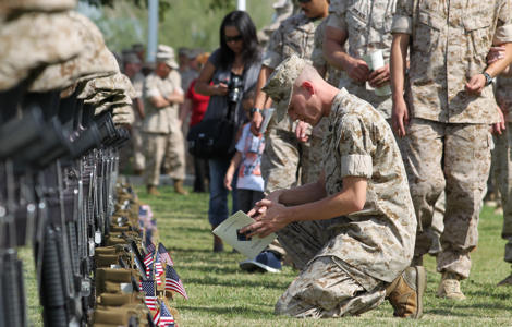 A Marine bows his head in remembrance of a fallen Marine during the Regimental Combat Team 7 memorial ceremony Oct. 15, 2010 at Lance Cpl. Torrey L. Gray Field. The units attached to RCT-7 were deployed to Afghanistan from Oct. 24, 2009 to Sept. 28, 2010.