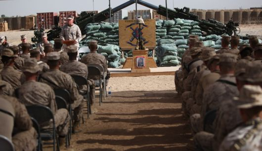 "Marines with 1st Battalion, 11th Marine Regiment, Regimental Combat Team 2, gather at Firebase Fiddler's Green, Aug. 30, 2010 to honor their fallen brother, Sgt. Ronald A. Rodriguez. Rodriguez was killed in action, Aug. 23, at the age of 26. The short, quiet ceremony was marked by Bible verses and prayers honoring Rodriguez. Final roll was called and three times, Sergeant. Ronald A. Rodriguez' name was called only to be answered by silence. ""Taps"" followed in a final farewell."
