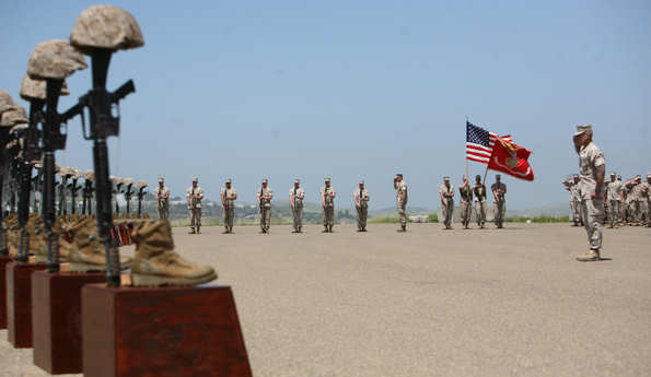 Marines with 3rd Battalion, 5th Marine Regiment, salute during the playing of taps during a memorial ceremony, April 29, 2011. Moments before, the Marines fired a 21-gun salute in honor of the 25 fallen warriors of the battalion.