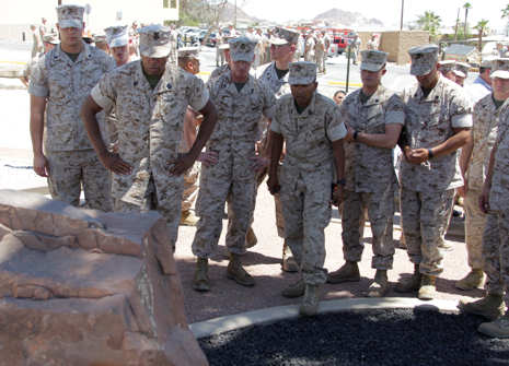 Marines and sailors of 3rd LAR pause to reflect at their new memorial dedicated to the Wolf Pack Marines who lost their lives during Operation Iraqi Freedom after the dedication ceremony of their memorial park June 14, 2011 in front of the 3rd LAR headquarters building.
