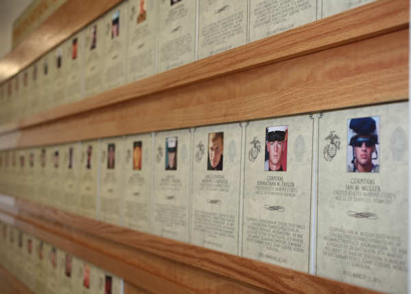 The culmination of almost four months of hard work finally paid off when the Hall of Heroes was officially opened during a ceremony aboard Marine Corps Base Camp Lejeune, N.C., August 8, 2011. The wall of photographs was created to honor all 133 Marines and sailors from the 2nd Marine Division who gave their lives during Operation Enduring Freedom. Photo by USMC Pvt. Brian M. Woodruff