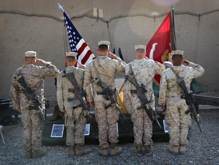 Marines with 3rd Battalion, 5th Marine Regiment, Regimental Combat Team 2, salute the memorial of their fallen brothers during a ceremony, Oct. 30. Lance Corporals Joseph Rodewald, 22, Phillip Vinnedge, 19, Victor Dew, 20, and Cpl. Justin Cain, 22, with Weapons Company were killed in action, Oct. 13, and Sgt. Ian Tawney, 25, with Lima Company was killed in action, Oct. 16, 2010.