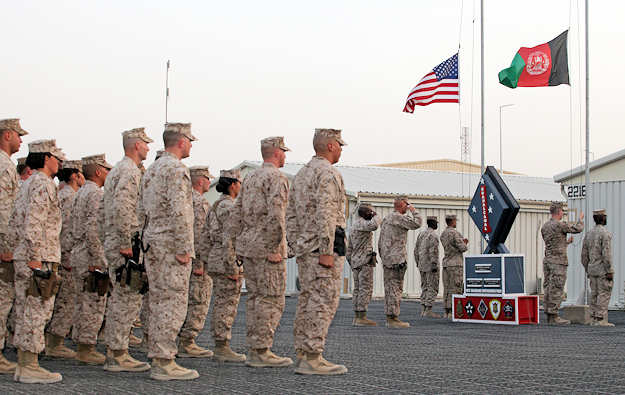 U.S. Marine Corps Maj. Gen. David H. Berger, commanding general of Task Force Leatherneck, and Sgt. Maj. Terry L. Jones, Sergeant Major of Task Force Leatherneck, salute the American flag during a Memorial Day ceremony aboard Camp Leatherneck, Afghanistan on May 28, 2012. Marines, Sailors, Afghan National Army Soldiers, and Department of Defense civilians gathered to honor fallen service members. U.S. Marine Corps photo by Sgt. Marionne T. Mangrum