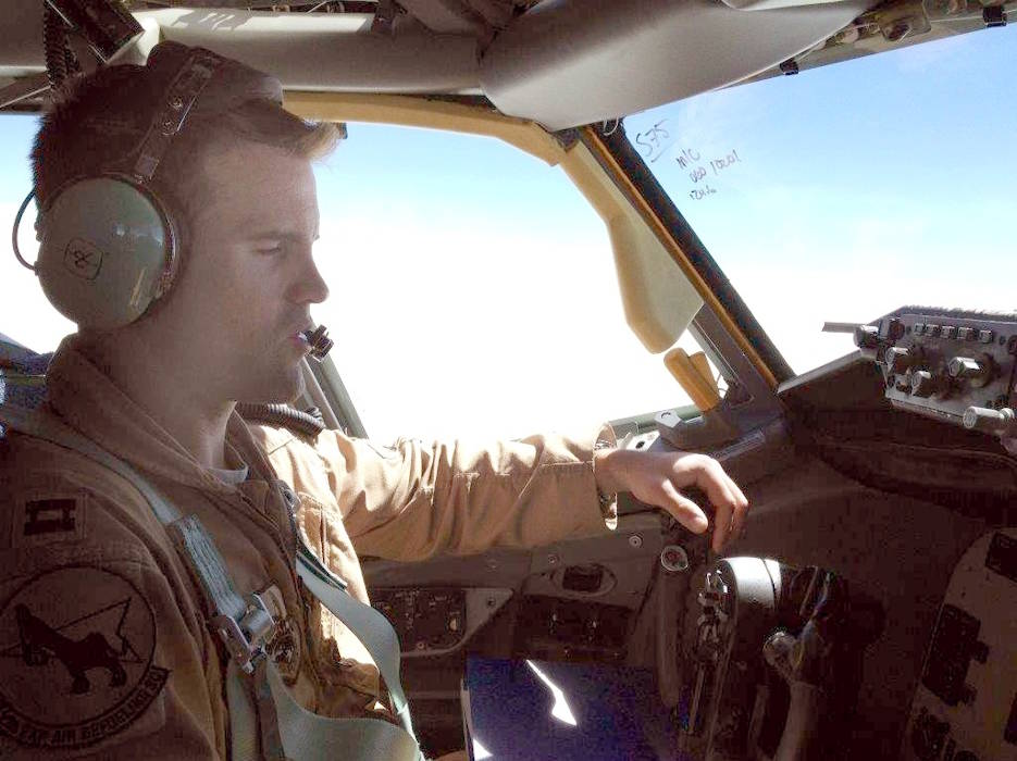 "U.S. Air Force Capt. Mark ""Tyler"" Voss in an aircraft at an undisclosed location and time period. He perished in a plane crash near Chon-Aryk, Kyrgyzstan, while on his sixth deployment. (Photo courtesy of Mark Voss's family)"