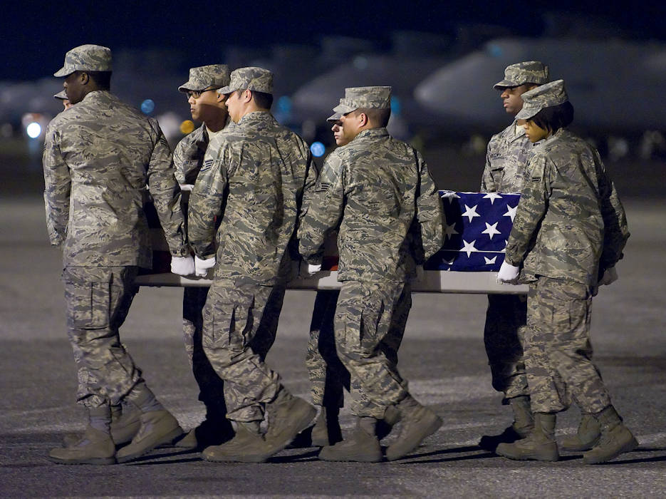 U.S. Air Force airmen transfer the remains of Air Force Staff Sgt. Phillip A. Myers during an arrival ceremony at Dover Air Force Base, Delaware on April 5, 2009. Sergeant Myers died April 4, 2009 near Helmand Province, Afghanistan, from wounds suffered from an improvised explosive device. He was assigned to the 48th Civil Engineer Squadron, Royal Air Force Lakenheath, United Kingdom. Sergeant Myers' family is the first to allow media to cover the dignified transfer under the new Department of Defense policy. (DoD photo by Roland Balik, U.S. Air Force)