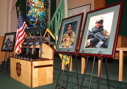 The 3rd Special Forces Group (Airborne) held a unit memorial on June 23, 2011at the John F. Kennedy Chapel on Fort Bragg to honor recently fallen soldiers (from left to right): Capt. Joseph W. Schultz, Sgt. 1st Class Martin R. Apolinar and Sgt. Aaron J. Blasjo. The fallen were members of Operational Detachment Alpha 3333, Company C, 3rd Battalion, 3rd SFG (A) and were killed in combat on May 29, 2011. U.S. Army photo by Sgt. Enoch Fleites