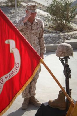 "Cpl. Jeffery Holsey, a machine gun team leader with India Company, 3rd Battalion, 5th Marine Regiment pays tribute to a fallen brother, machine gunner Lance Cpl. John T. Sparks at a memorial ceremony in Sangin, Oct, 16, 2010. Sparks, 23, was killed in action, Oct. 8, 2010. ""My friend is gone and it seems that no matter what I do the pain in my heart won't go away,"" said Holsey, a roommate of Sparks. ""John had the best qualities a person could ask for. He was always laughing and always smiling. He never let the troubles of the world get him down."""
