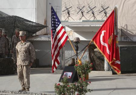 U.S. Marine Corps 1st Sgt. Yomen English, the company first sergeant for India Company, 3rd Battalion, 5th Marine Regiment calls roll for Lance Cpl. John T. Sparks at a memorial ceremony in Sangin, Oct. 16, 2010. Sparks, 23, was killed in action, Oct. 8, 2010. Sparks was a machine gunner with Weapons Platoon, India Company, 3rd Battalion, 5th Marines. At the memorial, Marines from 3/5 assigned to Regimental Combat Team 2 in Sangin, paused to honor their fallen brother.