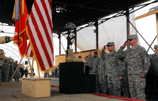 Col. Paul Calvert (foreground, left), commander of 2nd Advise and Assist Brigade, 1st Infantry Division, United States Division – Center, and Command Sgt. Maj. Rodney R. Lewis (foreground, right), command sergeant major of 2nd AAB, 1st Inf. Div., render a final salute Jan. 19, 2011 at a memorial service at Joint Security Station Loyalty, Iraq, honoring the life of Spc. Jose Torre, Jr., formerly with Company C, STB, 2nd AAB, 1st Inf. Div. Torre died, Jan. 15, in Baghdad of wounds suffered when insurgents attacked his unit.