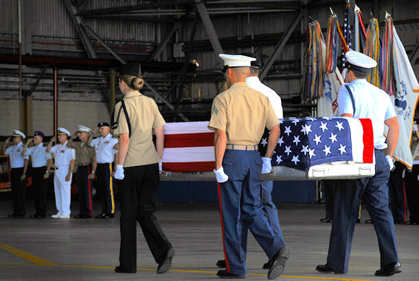 Military members transfer the remains of a U.S. service member June 17, 2011, during an arrival ceremony at Joint Base Pearl Harbor-Hickam, Hawaii. The unidentified remains were recovered by members of the Joint Pacific Accounting Command. Following the ceremony, with full military honors, the remains were sent to JPAC's Central Identification Laboratory where forensic identification analysis will be conducted so they may be identified and returned to member's family. (U.S. Air Force photo/Senior Airman Lauren Main