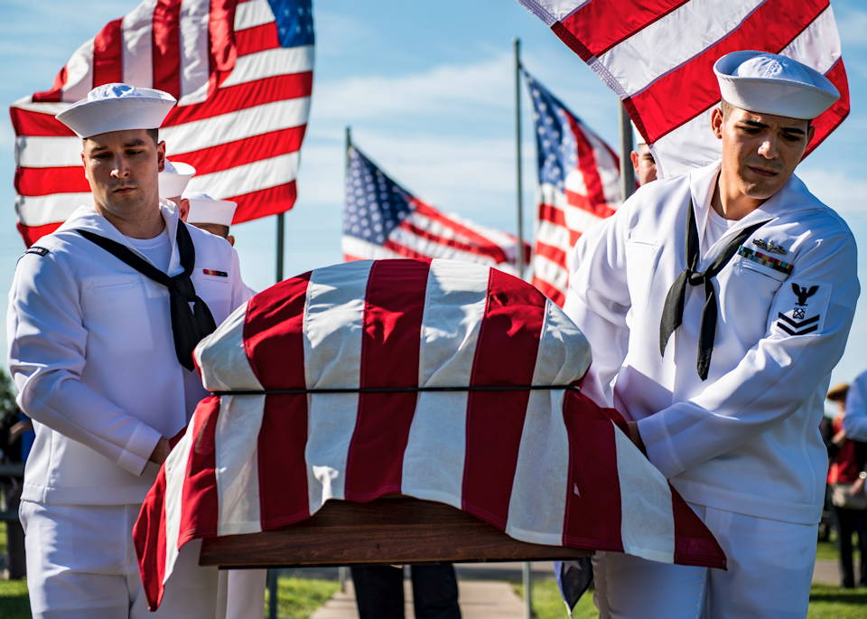 September 14, 2019 - Sailors assigned to Naval Operations Support Center, Wichita, render military funeral honors for Seaman 2nd Class Wilbur Clayton Barrett during a funeral in his hometown of El Dorado, Kansas. Barrett was killed aboard the battleship USS Oklahoma (BB-37) during the Dec. 7, 1941 Japanese attack on Pearl Harbor. (U.S. Navy photo by Mass Communication Specialist 2nd Class Justin R. Pacheco)