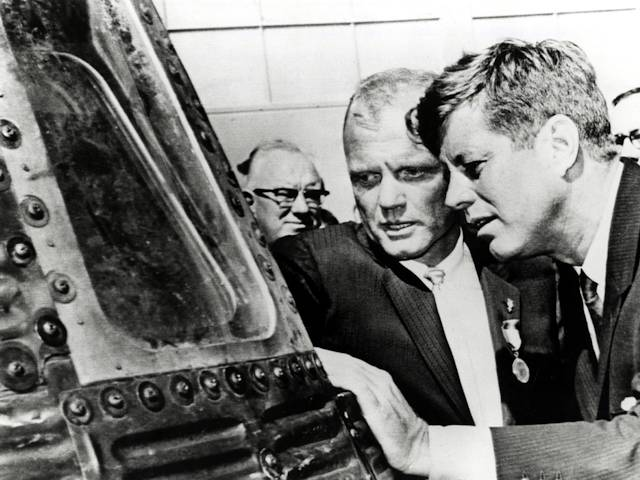 Astronaut John Glen shows President John Kennedy the Friendship Seven space capsule after being awarded a medal by the President on  February 23, 1962.