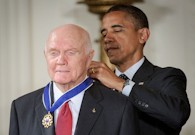 Former U.S. Senator and Astronaut John Glenn receives the Presidential Medal of Freedom from President Barack Obama on May 29, 2012.
