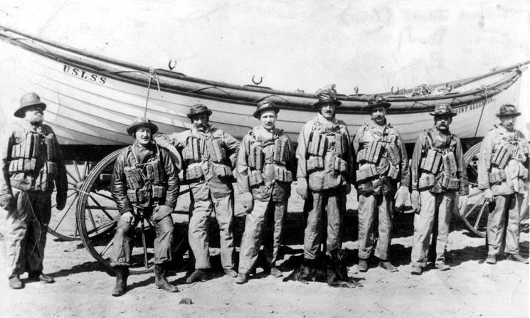 A rare photograph of Keeper Joshua James and his U.S. Life-Saving Service crew posing in front of their surfboat. (U.S. Coast Guard photo)