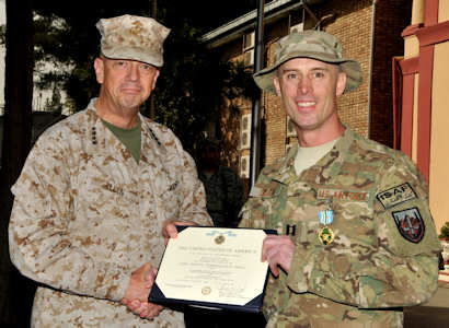 Marine Corps Gen. John R. Allen, commander of NATO and International Security Assistance Force troops in Afghanistan, presented the Joint Service Commendation Medal with Valor to Air Force Capt. Darrel A. DeLeon, during a ceremony at ISAF Headquarters in Kabul, Afghanistan, September 25, 2011 for heroic actions at Camp Phoenix in Kabul on April 2, 2011. U.S. Air Force photo by Master Sgt. Michael O'Connor