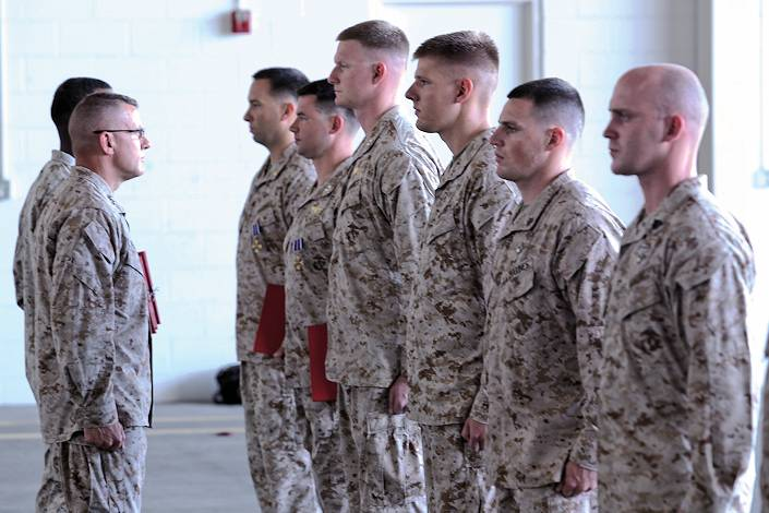 Maj. Gen. Robert F. Hedelund, 2nd Marine Aircraft Wing commanding general, presented Marines from Marine Medium Tiltrotor Squadron 365 with two distinguished flying crosses and five air medals in their hangar aboard Marine Corps Air Station New River on June 28, 2013. The Marines were awarded for the bravery and courage shown during a mission to insert a reconnaissance raid force into a heavily defended enemy landing zone in Afghanistan in June 2012. (U.S. Marine Corps photo by Cpl. Manuel Estrada)