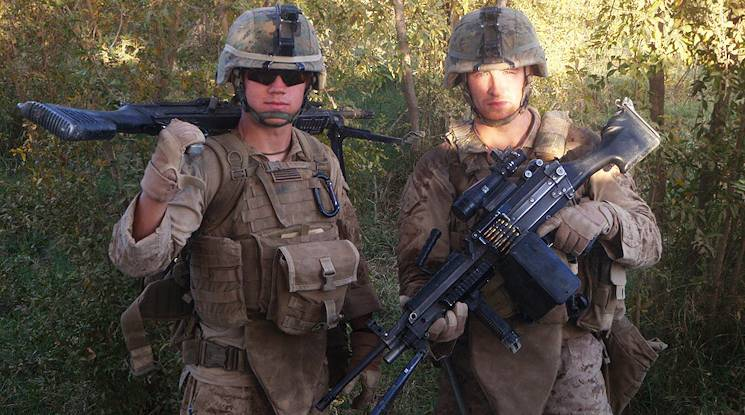 U.S. Marine Corps Lance Cpls. Kyle Carpenter (left) and Nicholas Eufrazio are pictured in Marjah, Afghanistan during their 2010 deployment.  (Forward), in Helmand Province, Afghanistan. (Photo courtesy of U.S. Marine Corps)