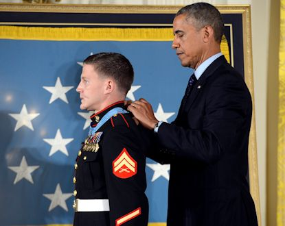 "President Barack Obama awards the Medal of Honor to retired Marine Corps Cpl. William ""Kyle"" Carpenter during a ceremony at the White House in Washington, June 19, 2014. Carpenter became the eighth living recipient of the Medal of Honor from the wars in Iraq and Afghanistan for his heroic actions Nov. 21, 2010, when he shielded a fellow Marine from an enemy hand grenade with his body. At the time of his heroic actions, Carpenter served in Company F, 2nd Battalion, 9th Marines, Regimental Combat Team 1, 1st Marine Division (Forward), I Marine Expeditionary Force (Forward), in Helmand province, Afghanistan. (Department of Defense photo by EJ Hersom)"
