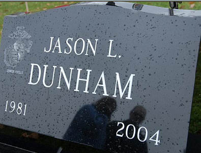 Parents Deb and Dan Dunham visit their son's grave on November 3, 2006.