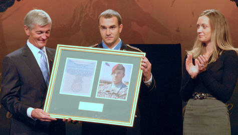 "Secretary of the Army John McHugh presents Staff Sgt. Salvatore ""Sal"" Giunta with a framed copy of Giunta's Medal of Honor citation for his actions in the Korengal Valley, Afghanistan, during a Hall of Heroes ceremony at the Pentagon Nov. 17, 2010 while Giunta's wife Jennifer looks on. On Oct. 25, 2007, Giunta single-handedly rescued a wounded buddy from being kidnapped by two enemy fighters."