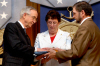 U.S. Deputy Defense Secretary Gordon England, left, presents the Medal of Honor flag to Tom and Romayne McGinnis, parents of Army Pfc. Ross A. McGinnis, during a ceremony in the Pentagon's Hall of Heroes, June 3, 2008. McGinnis was awarded the medal posthumously for his valor in battle in Iraq in an act that saved three lives.