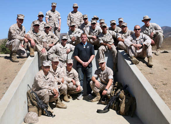 Marines with 1st Reconnaissance Battalion, 1st Marine Division, pose with Sgt. Dakota Meyer, Medal of Honor recipient, at Range 218, Sept. 27, 2011. Meyer visited with Marines from multiple units across Camp Pendleton in his final tour before returning home. Photo by USMC Cpl. Ned Johnson