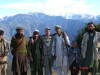 Personal photo of Sgt. 1st Class Jared C. Monti (center) with locals in Afghanistan, 2006