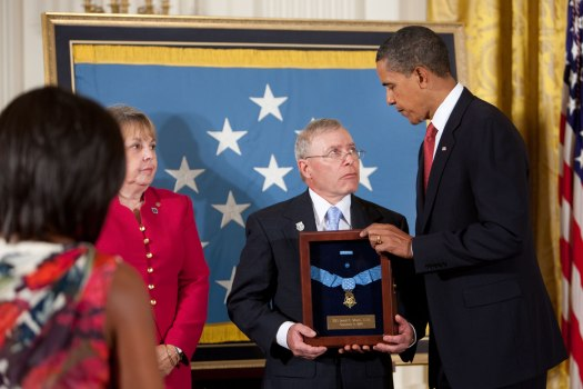 President Barack Obama stands with Paul and Janet Monti as he posthumously awards their son, Army Sgt. 1st. Class Jared C. Monti from Raynham, Mass., the Medal of Honor for his service in Afghanistan during a ceremony in the East Room of the White House, Thursday, Sept. 17, 2009.