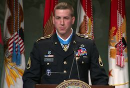 MOH Recipient Ryan Pitts salutes his fellow soldiers' valor during his Hall of Heroes Induction on July 22, 2014.