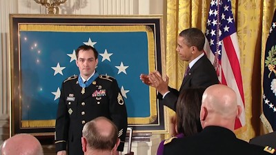 President Barack Obama awards Clinton Romesha, a former active duty Army staff sergeant, the Medal of Honor for conspicuous gallantry on February 11, 2013. Staff Sergeant Romesha received the Medal of Honor for his courageous actions during combat operations against an armed enemy at Combat Outpost Keating in Afghanistan on October 3, 2009.